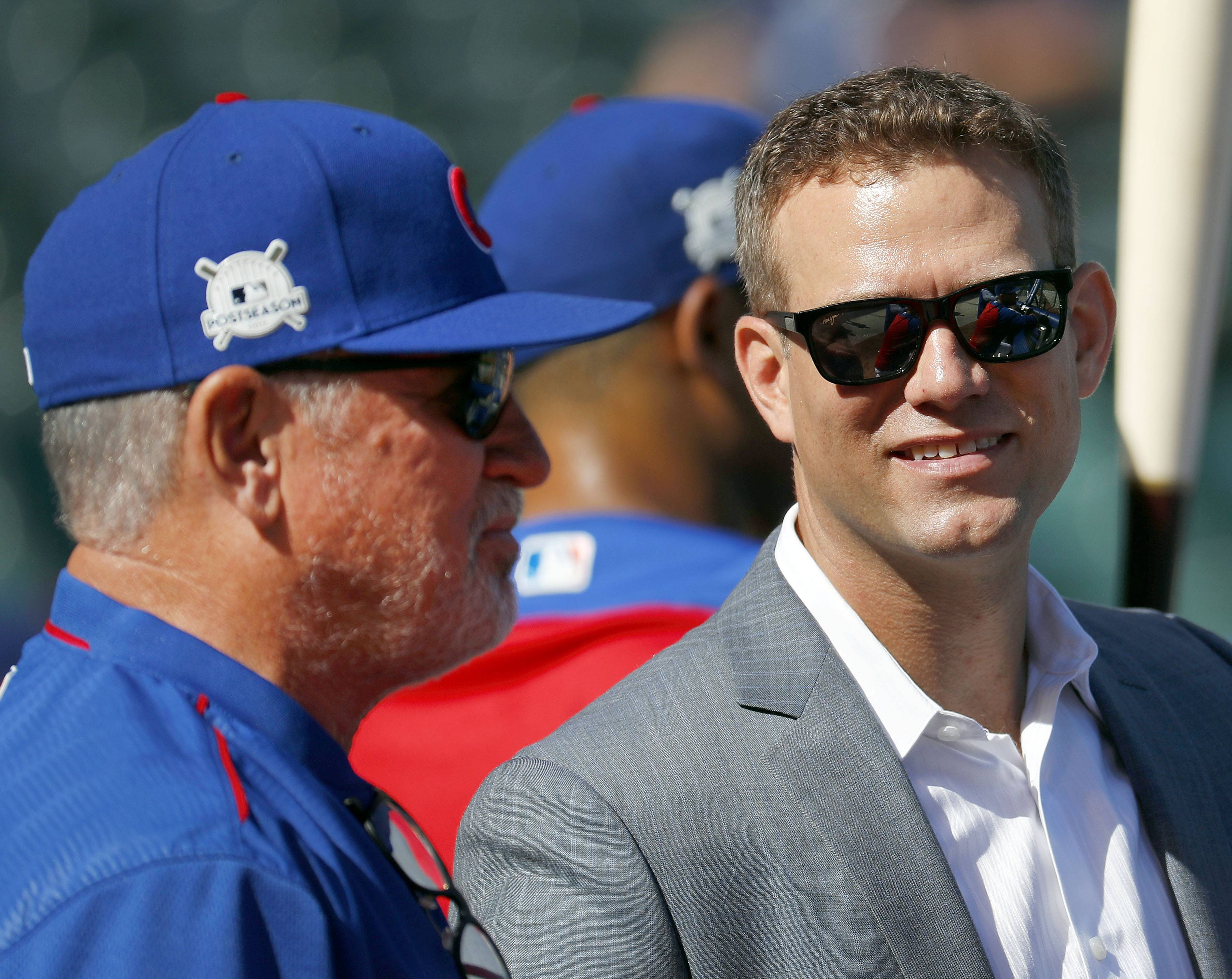 Theo Epstein has a few words with manager Joe Maddon prior to Game 3 of the National League Division Series in October 2017 at Wrigley Field.