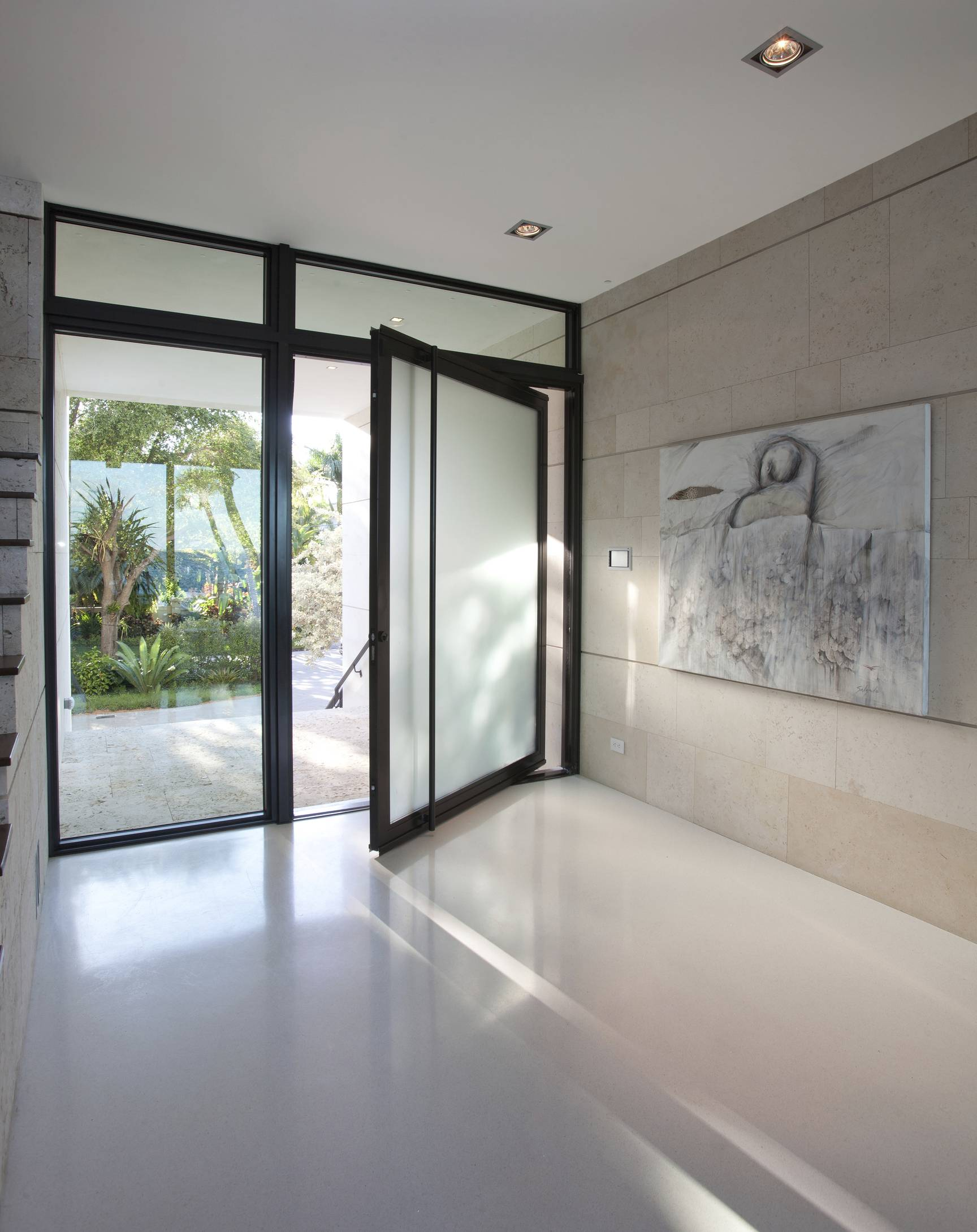 Designer Jacqueline Gonzalez Touzet says terrazzo flooring, as seen in this entryway to a Florida home, is a great choice due to its durability and long-lasting beauty.