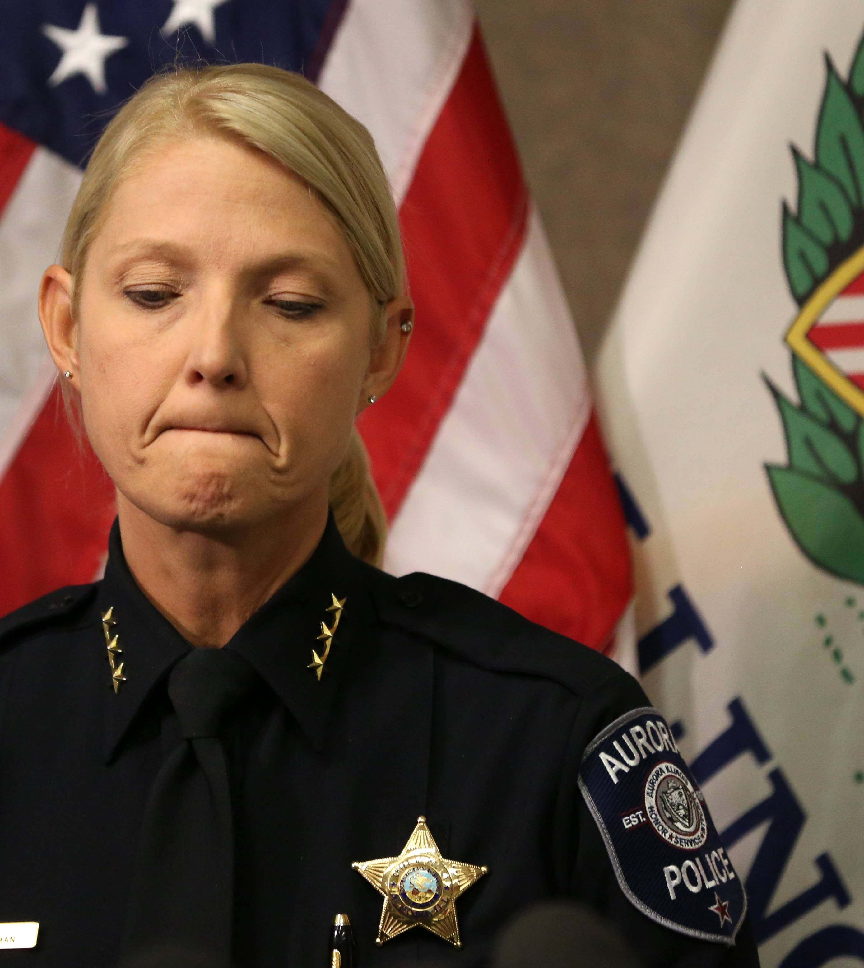 Aurora Police Chief Kristen Ziman pauses as she speaks about the loss of life Friday in the warehouse shooting.
