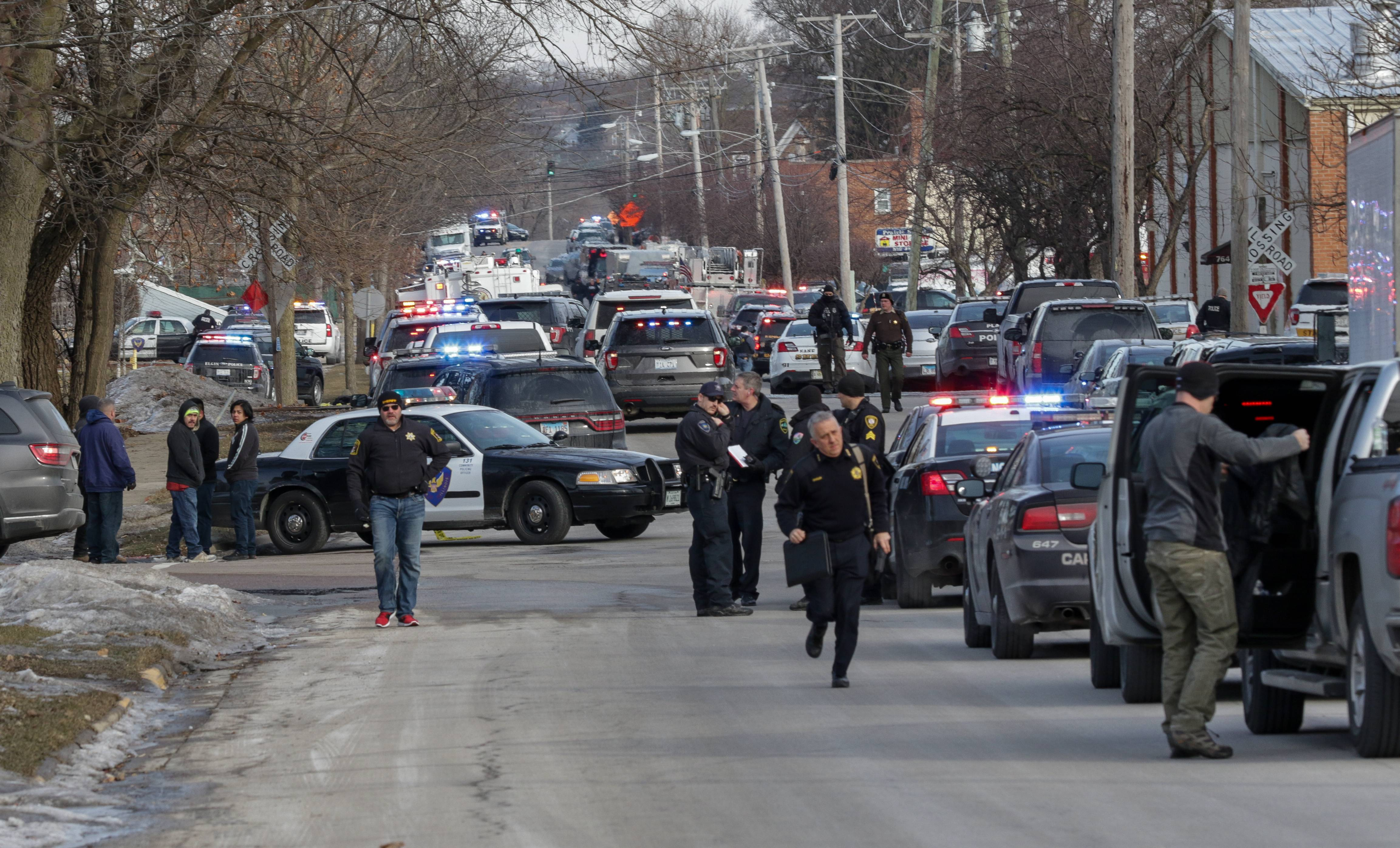 Five people were killed and five police officers and multiple civilians were wounded in an Aurora shooting Friday in an industrial area near Prairie and Highland avenues.