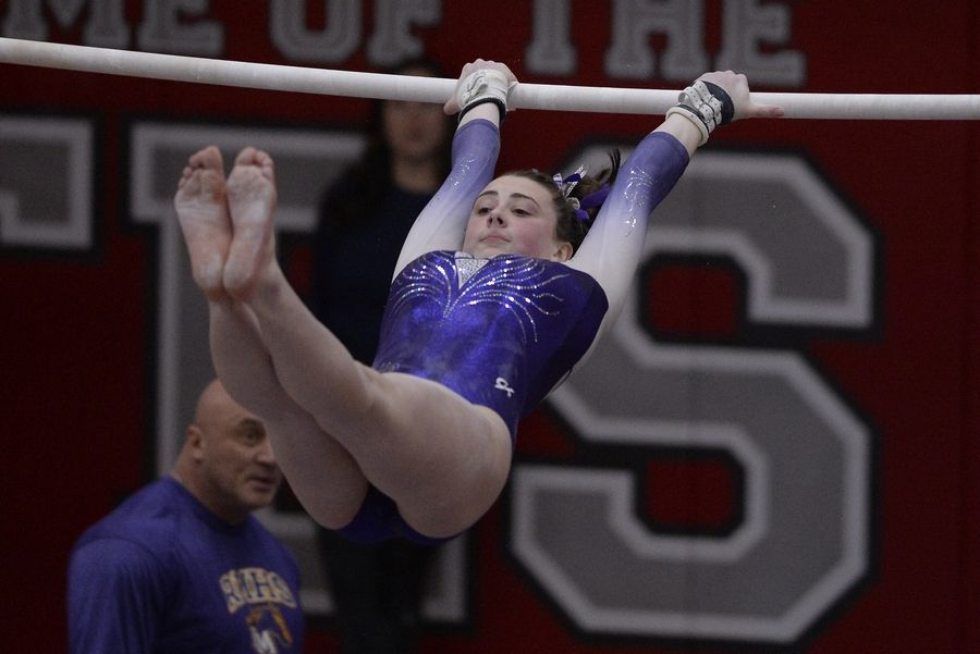 Rolling Meadows' Nicole Kane does her routine on the uneven parallel bars during the IHSA girls gymnastics preliminaries at Palatine High School on Friday.