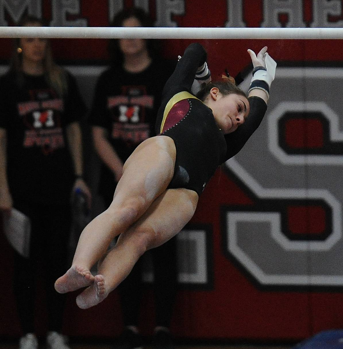 Schaumburg's Alexis Rothmeyer does her routine on the uneven parallel bars during the IHSA girls gymnastics preliminaries at Palatine High School on Friday.
