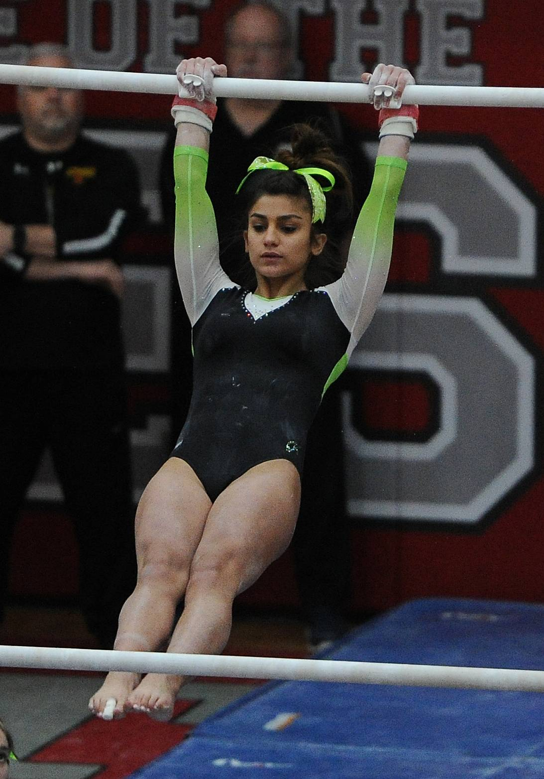 Fremd's Gianna Christodoulopoulos does her routine on the uneven parallel bars during the IHSA girls gymnastics preliminaries at Palatine High School on Friday.