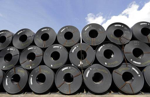 FILE - In this June 5, 2018, file photo, rolls of steel are shown in Baytown, Texas. Despite President Donald Trump's tough talk on trade, his administration has granted hundreds of companies permission to import millions of tons of steel made in China, Japan and other countries without paying the hefty tariff he put in place to protect U.S. manufacturers and jobs, according to an Associated Press analysis.