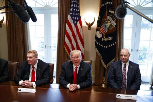 FILE - In this March 1, 2018, file photo, President Donald Trump speaks during a meeting with steel and aluminum executives in the Cabinet Room of the White House in Washington, with Nucor's John Ferriola, left, and Dave Burritt of U.S. Steel Corporation. Hundreds of companies have been granted permission to import millions of tons of steel made in China, Japan and other countries without paying the hefty tariff Trump put in place.