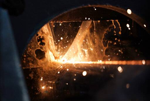 FILE - In this June 5, 2018, file photo, steel is forged to make a pipe at the Borusan Mannesmann Pipe manufacturing facility in Baytown, Texas. Hundreds of companies have been granted permission to import millions of tons of steel made in China, Japan and other countries without paying the hefty tariff Trump put in place.
