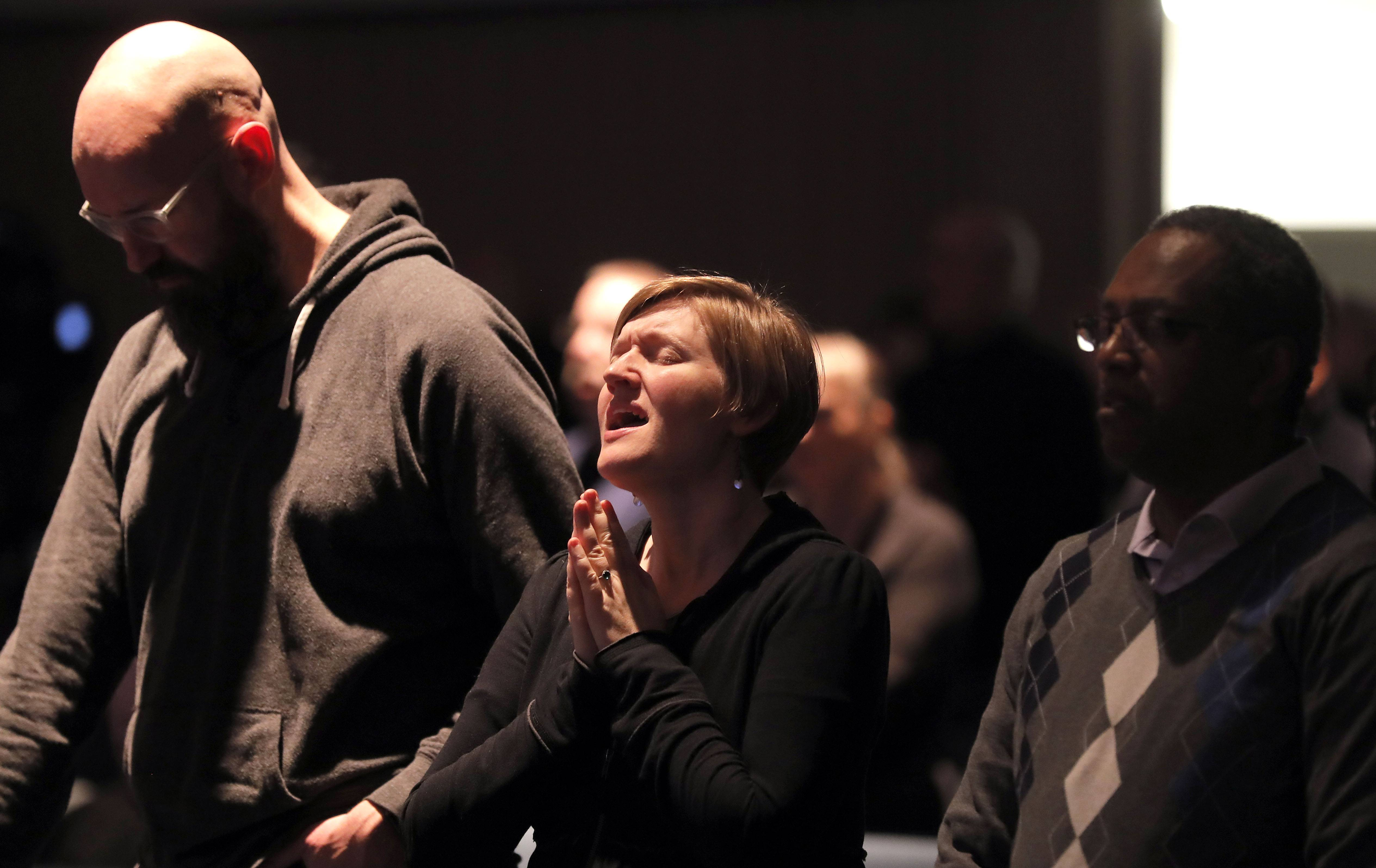 People worship during a prayer vigil for the victims of the Aurora shooting at Highpoint Church's North Aurora Campus Saturday night.