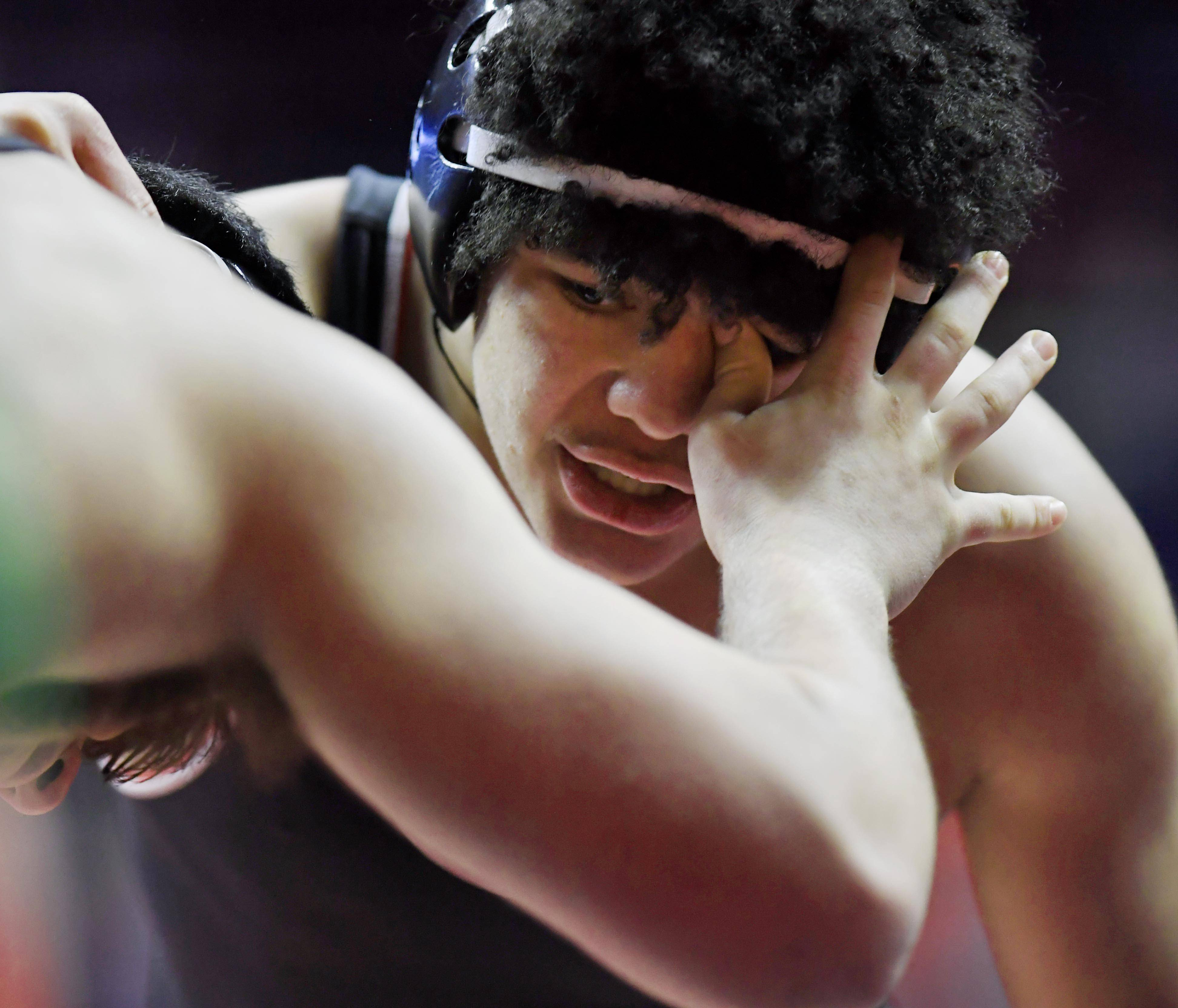 Barrington's Dayven Shinhoster gets poked in the eye by Deerfield's Cody Goodman in the Class 3A 195-pound semifinal wrestleback bout at the 2019 IHSA wrestling state championships at State Farm Center at the University of Illinois in Champaign Saturday.