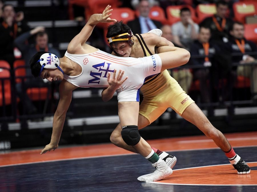 Montini's Nick Gonzalez throws Marmion Academy's Diego Sotelo in the Class 3A 106-pound championship bout at the 2019 IHSA wrestling state championships at State Farm Arena at the University of Illinois in Champaign Saturday.