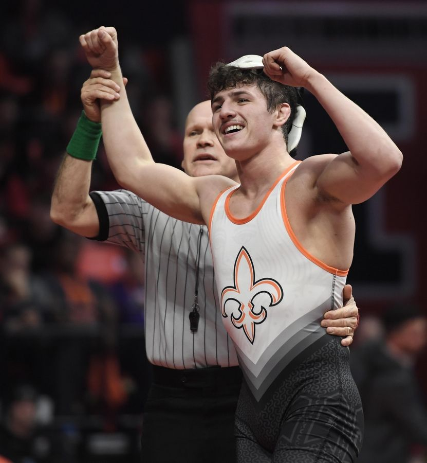 St. Charles East's Justin Benjamin celebrates his win against Marmion Academy's Ryan Fleck in the Class 3A 138-pound championship bout at the 2019 IHSA wrestling state championships at State Farm Arena at the University of Illinois in Champaign Saturday.
