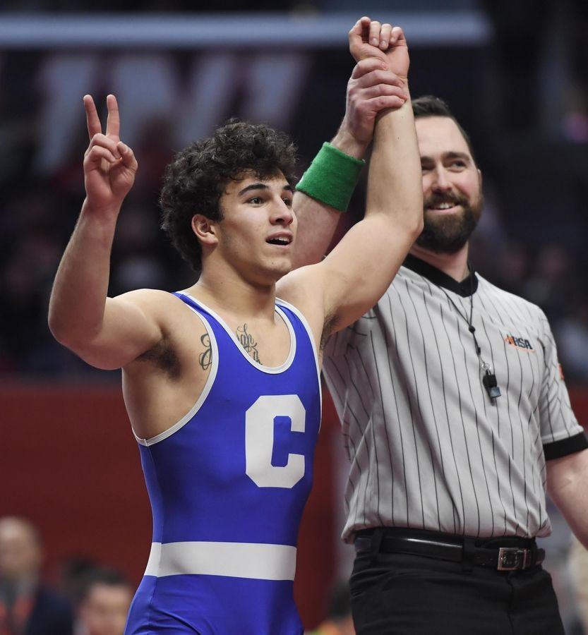 Burlington Central's Nick Termini celebrates his second straight state championship Saturday in the Class 2A 145-pound bout at the 2019 IHSA wrestling state championships at State Farm Arena at the University of Illinois in Champaign Saturday.