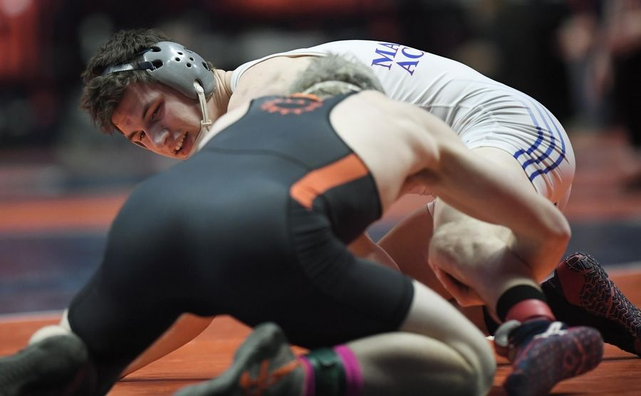 Marmion Academy's Brad Gross looks for an opening against St. Charles East's Tommy Schroeder in the Class 3A 160-pound third place bout at the 2019 IHSA wrestling state championships at State Farm Arena at the University of Illinois in Champaign Saturday.