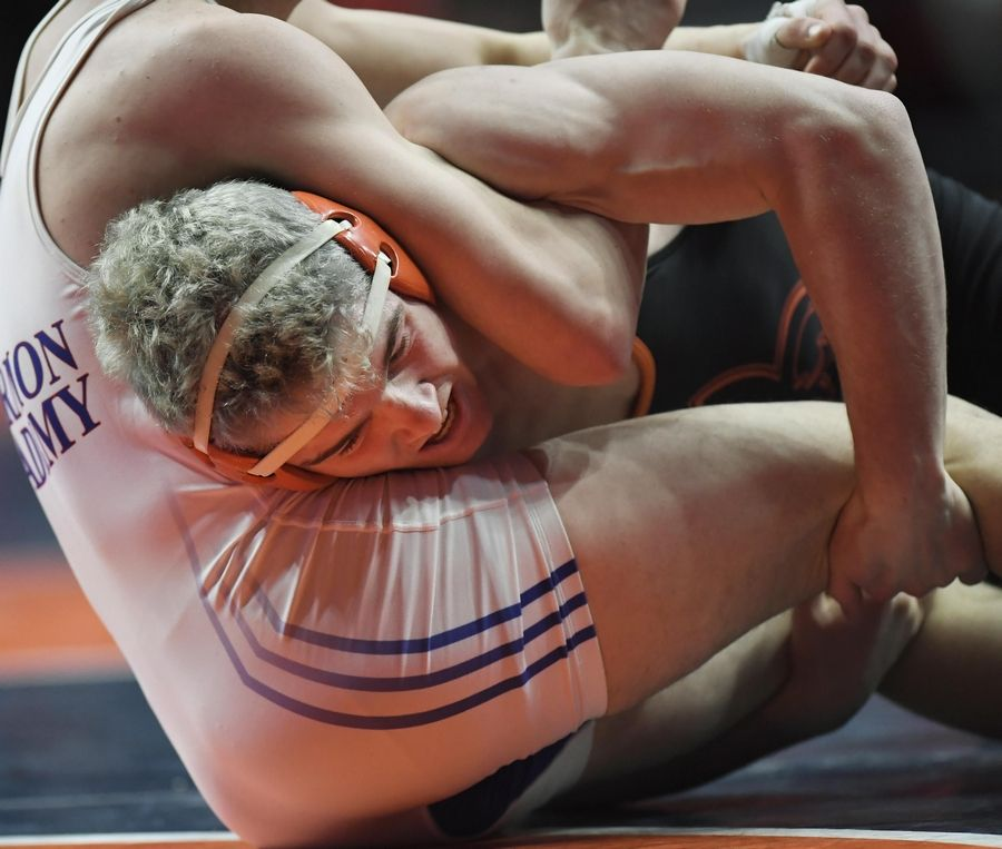 St. Charles East's Tommy Schroeder is wrapped up by Marmion Academy's Brad Gross in the Class 3A 160-pound third place bout at the 2019 IHSA wrestling state championships at State Farm Arena at the University of Illinois in Champaign Saturday.