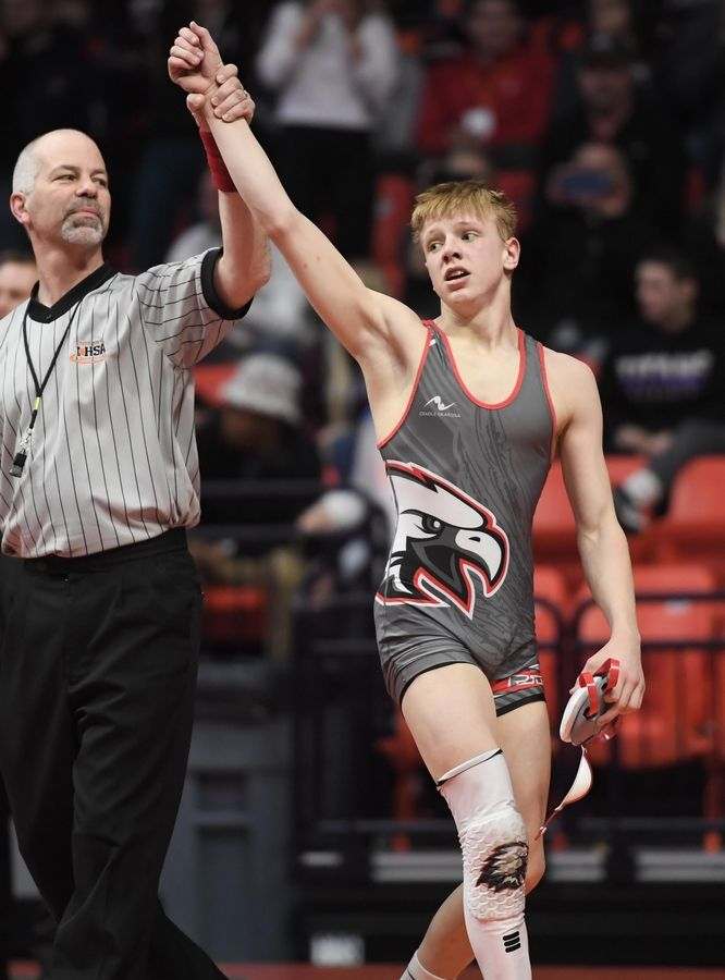 Aurora Christian's Joel Mylin os declared the winner in the Class 1A 106-pound championship bout at the 2019 IHSA wrestling state championships at State Farm Arena at the University of Illinois in Champaign Saturday.
