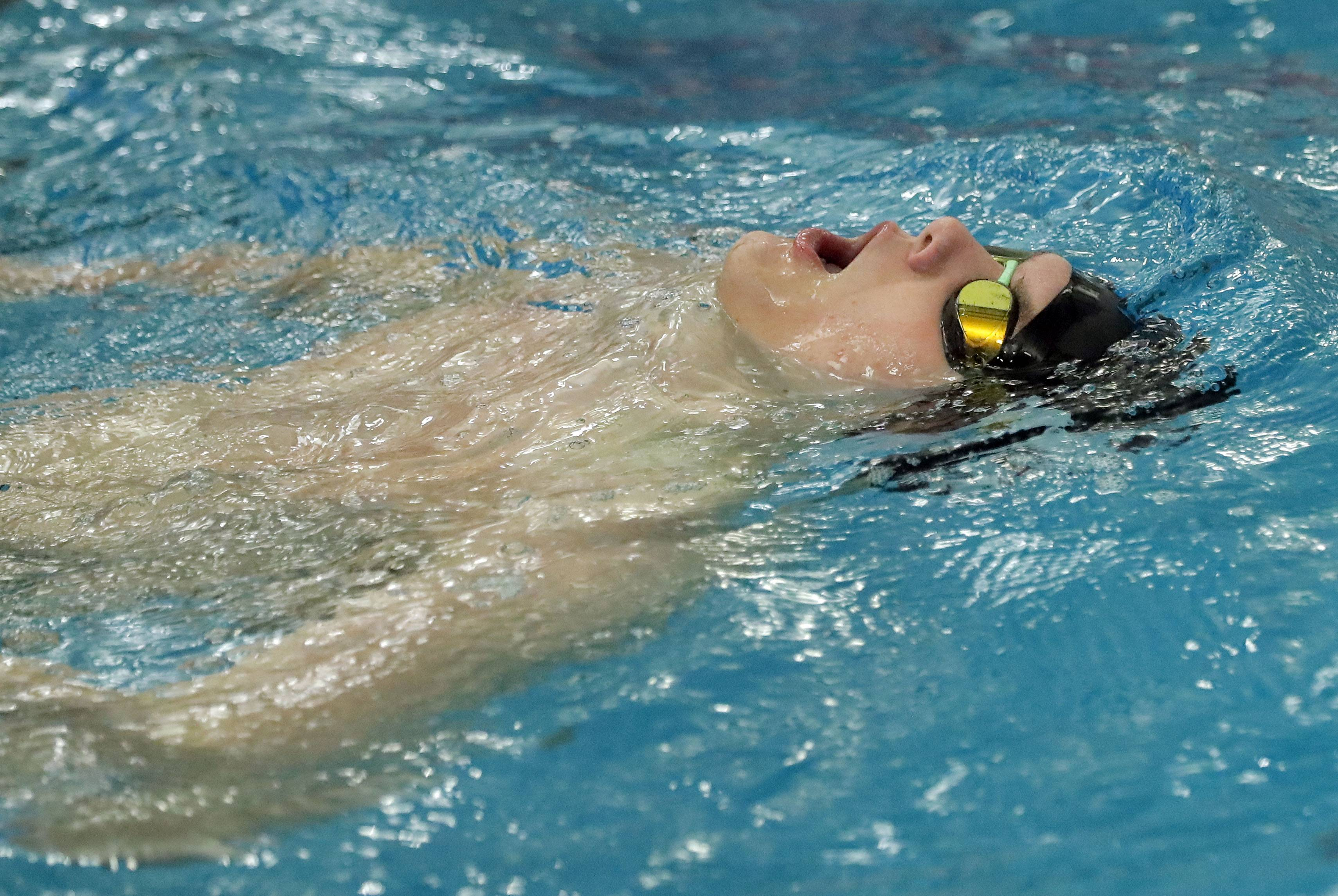 Barrington's Sam Burrell reacts after swimming in the 100-yard freestyle during boys sectional swimming at Barrington High School Saturday.
