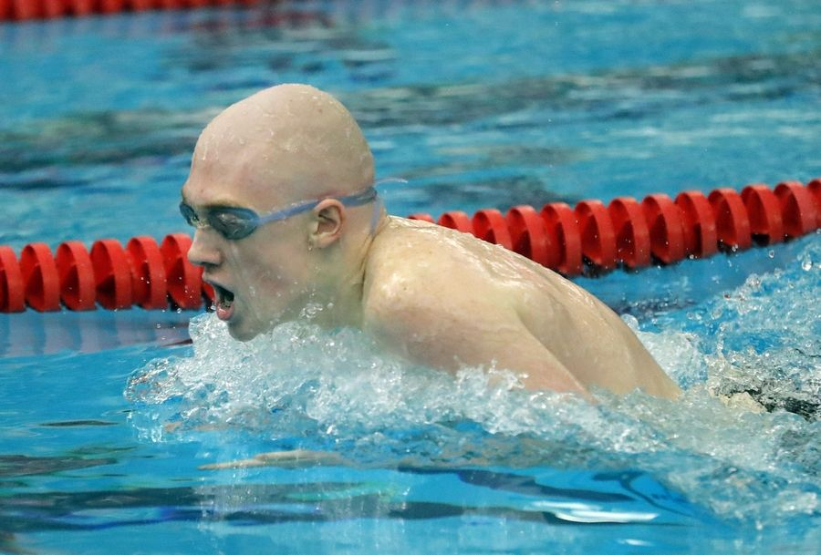 Palatine's Henry Gabriel swims in the 200-yard individual medley during boys sectional swimming at Barrington High School Saturday.