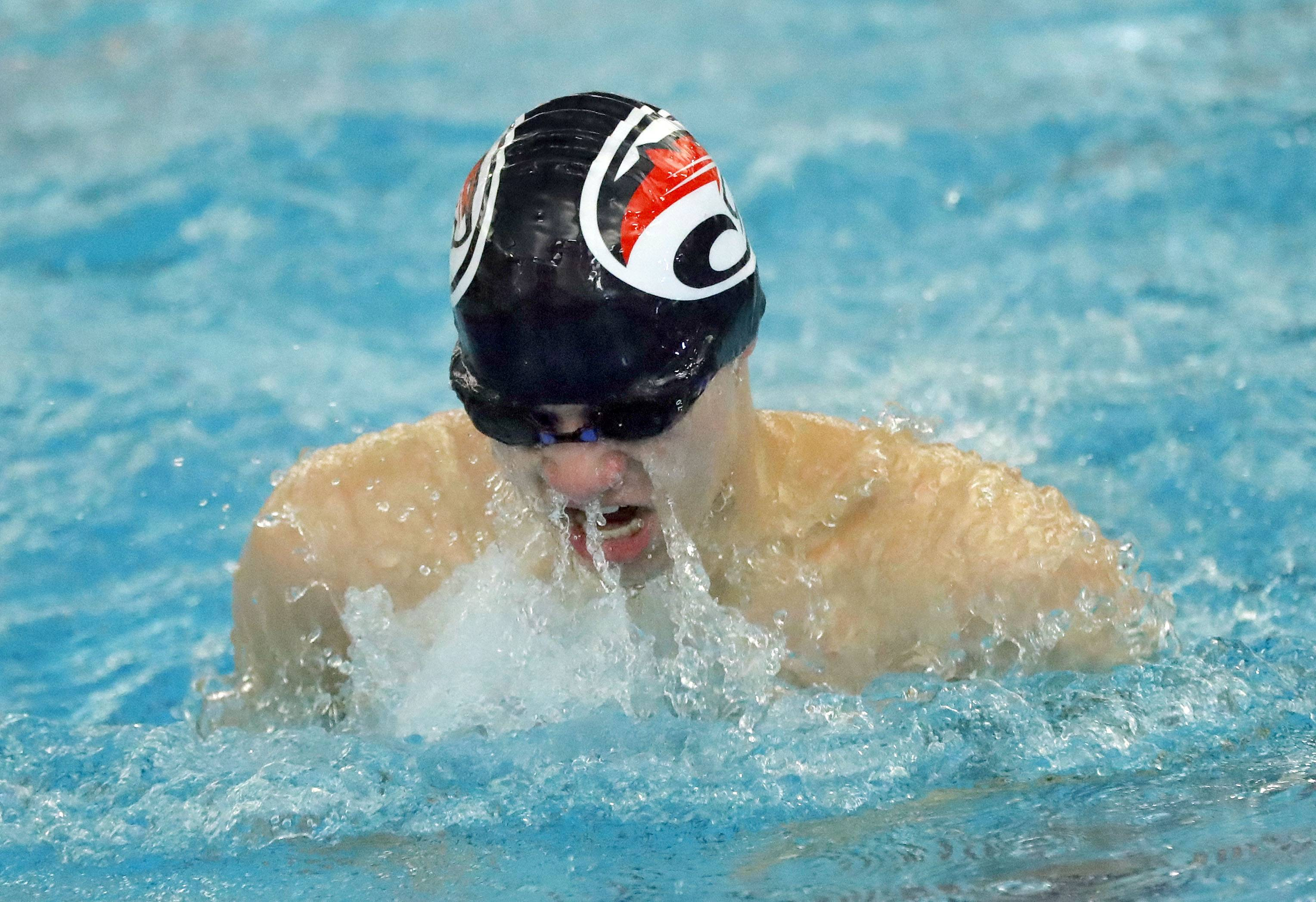 Conant's Dylan Pokorny swims in the 200-yard medley relay during boys sectional swimming at Barrington High School Saturday.