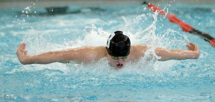 Barrington's Sam Burrell swims in the 200-yard medley relay during boys sectional swimming at Barrington High School Saturday.