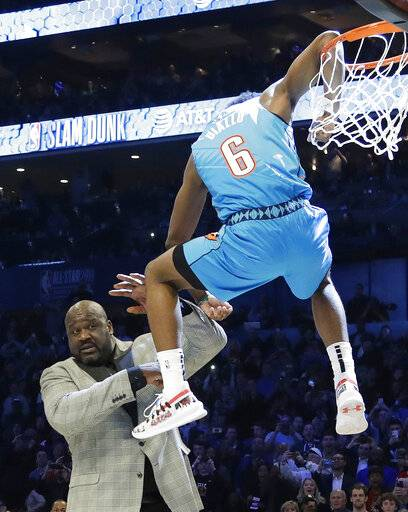 Oklahoma City Thunder Hamidou Diallo leaps over former NBA player Shaquille O'Neal during the NBA All-Star Slam Dunk contest, Saturday, Feb. 16, 2019, in Charlotte, N.C. Diallo won the contest. (AP Photo/Chuck Burton)