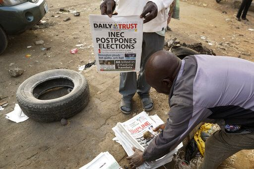The Latest: Nigerian president 'disappointed' by poll delay