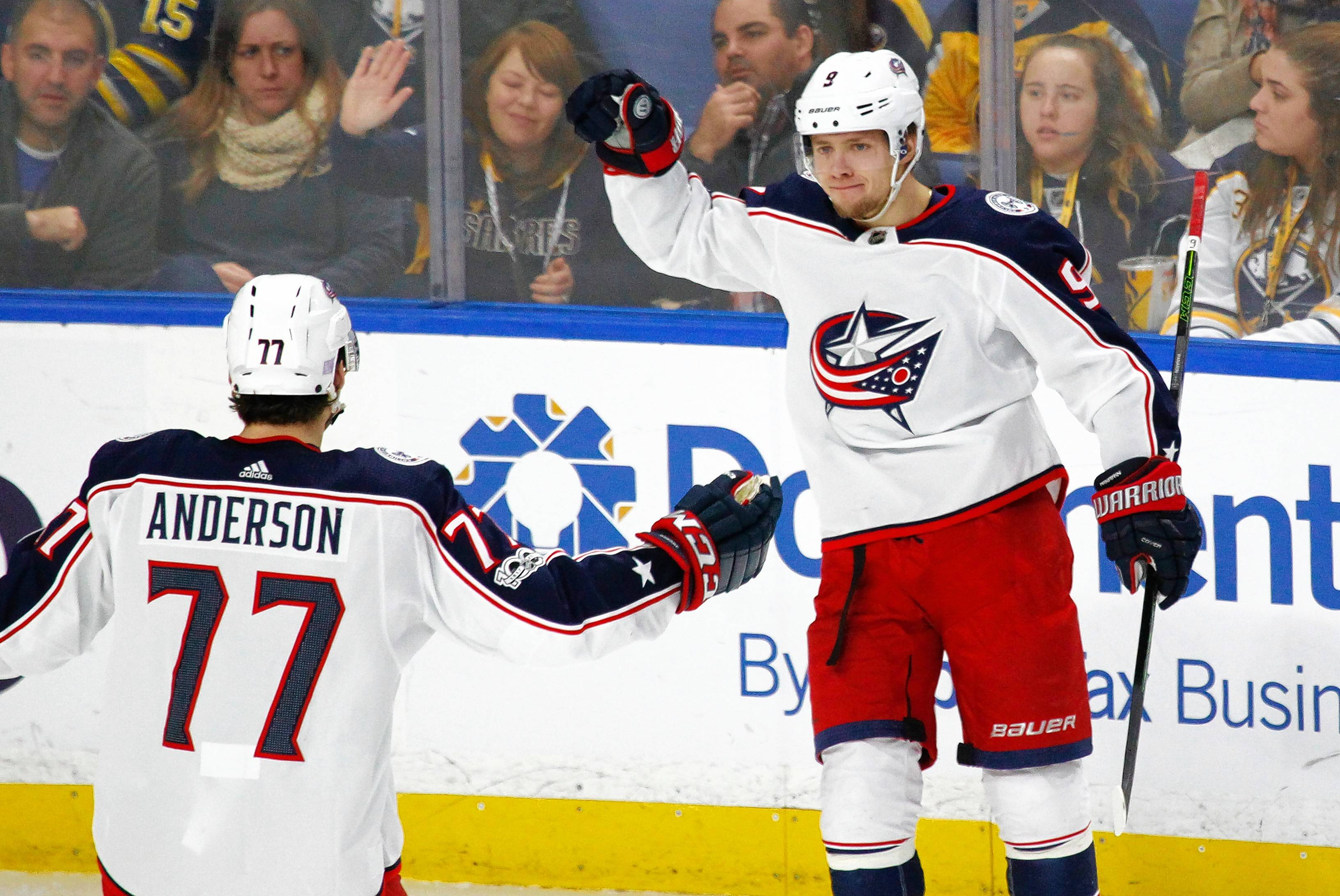 Columbus Blue Jackets Josh Anderson (77) and Artemi Panarin (9) celebrate a goal during the third period of an NHL hockey game against the Buffalo Sabres, Monday Nov. 20, 2017, in Buffalo, N.Y.