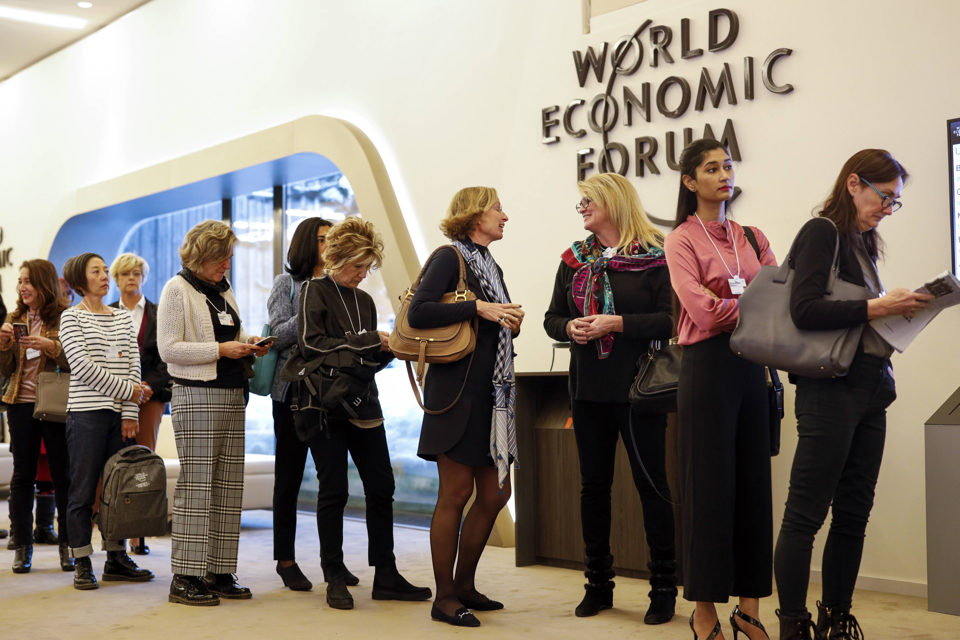 Female attendees line up for a panel session at the World Economic Forum in Davos, Switzerland, on Jan. 23, 2019. MUST CREDIT: Bloomberg photo by Jason Alden