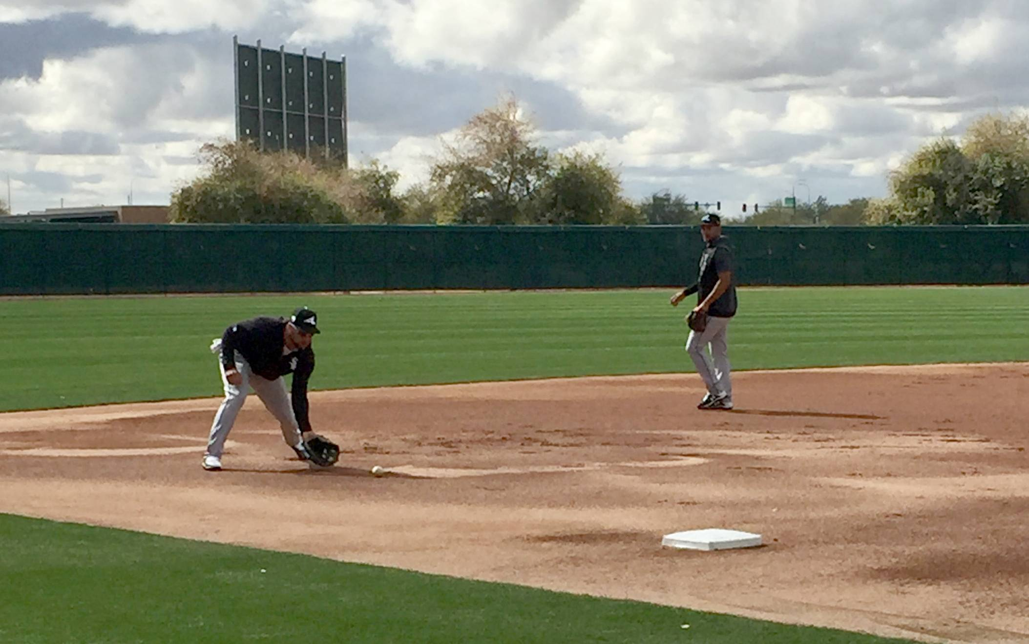 Yoan Moncada taking groundballs at third base and batting practice Monday.
