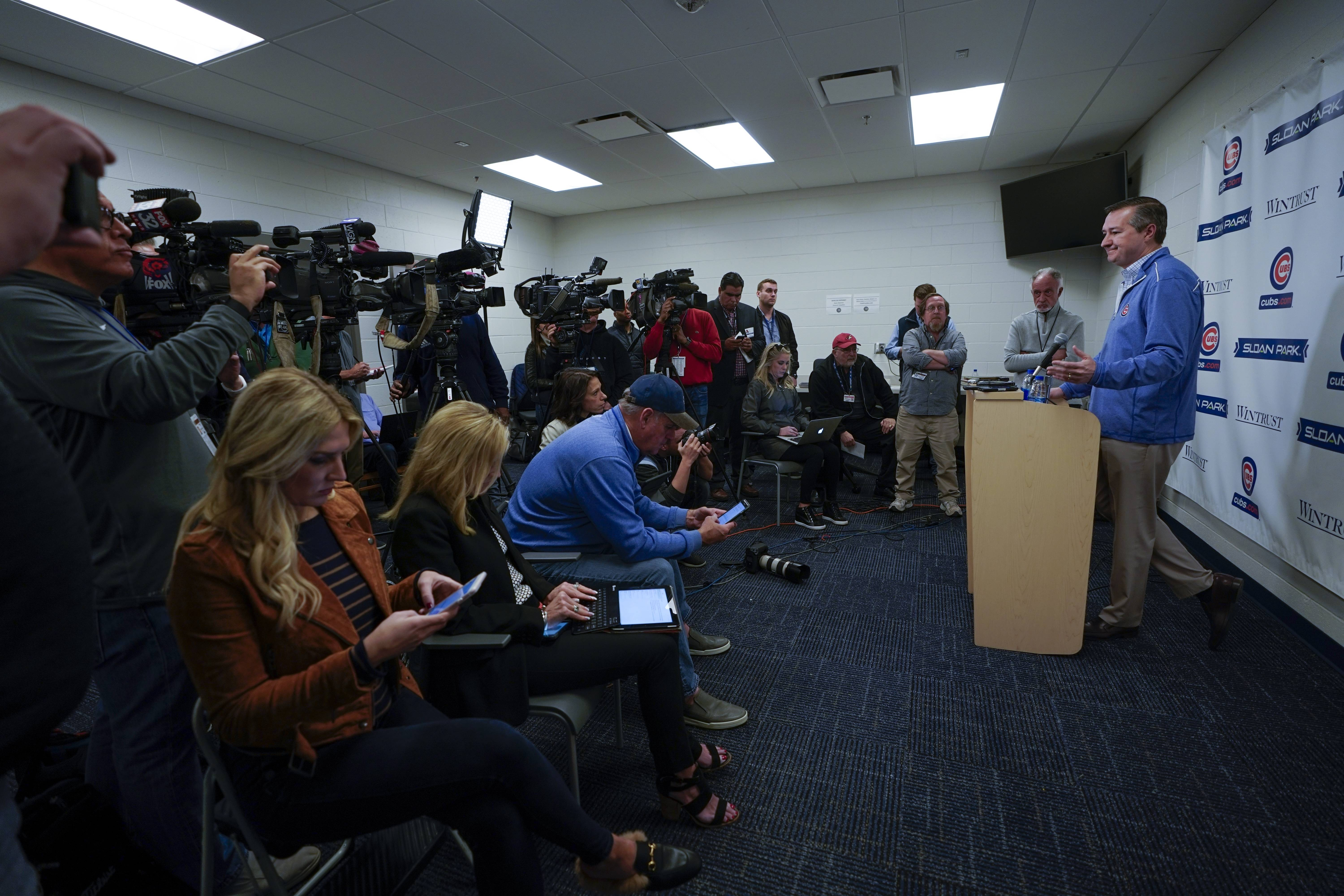 Cubs Chairman Tom Ricketts answers questions during a news conference at spring training Monday in Mesa, Ariz.