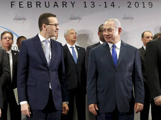 "File -- In this Thursday, Feb. 14, 2019 photo Poland's Prime Minister Mateusz Morawiecki, left, and Israeli Prime Minister Benjamin Netanyahu, right, attend a group photo during a meeting in Warsaw, Poland. Poland's prime minister canceled plans for his country to send a delegation to meeting in Jerusalem on Monday after the acting Israeli foreign minister Israel Katz said that Poles ""collaborated with the Nazis"" and ""sucked anti-Semitism from their mothers' milk""."