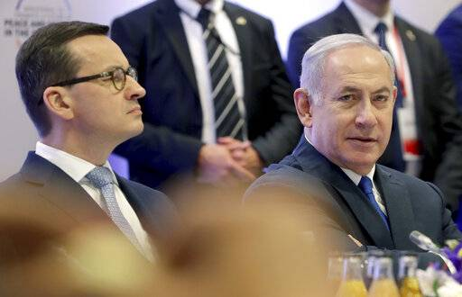 "File -- In this Thursday, Feb. 14, 2019 photo Poland's Prime Minister Mateusz Morawiecki, left, and Israeli Prime Minister Benjamin Netanyahu, right, attend a meeting in Warsaw, Poland. Poland's prime minister canceled plans for his country to send a delegation to meeting in Jerusalem on Monday after the acting Israeli foreign minister Israel Katz said that Poles ""collaborated with the Nazis"" and ""sucked anti-Semitism from their mothers' milk""."