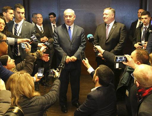 FILE - In this Thursday, Feb. 14, 2019 file photo, Israeli Prime Minister Benjamin Netanyahu, center left, and US Secretary of State Mike Pompeo, center right, address journalists on the sidelines of an international conference on the Middle East in Warsaw, Poland. An off-hand comment by Netanyahu in Warsaw about Poland and the Holocaust looks to overshadow a summit of central European leaders this week in Israel. Poland's abrupt decision Sunday to downgrade its participation in the Visegrad conference suddenly cast a pall gathering.