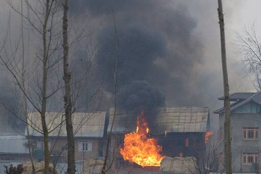 Flames and smoke billows from residential building where militants are suspected to have taken refuge during a gun battle in Pulwama, south of Srinagar, Indian controlled Kashmir, Monday, Feb. 18, 2019. Tensions continued to rise in the aftermath of a suicide attack in disputed Kashmir, with seven people killed Monday in a gunbattle that broke out as Indian soldiers scoured the area for militants.