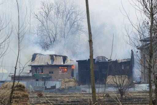 Flames and smoke billows from residential buildings where militants are suspected to have taken refuge during a gun battle in Pulwama, south of Srinagar, Indian controlled Kashmir, Monday, Feb. 18, 2019. Tensions continued to rise in the aftermath of a suicide attack in disputed Kashmir, with seven people killed Monday in a gunbattle that broke out as Indian soldiers scoured the area for militants.