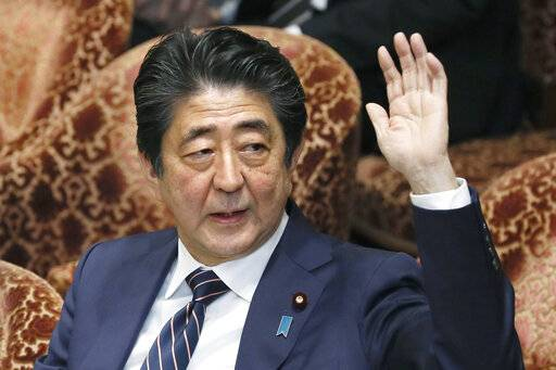"Japanese Prime Minister Shinzo Abe raises his hand during a parliamentary session at the Lower House in Tokyo, Monday, Feb. 18, 2019. Abe and his chief spokesman have declined to say if Abe nominated President Donald Trump for a Nobel Peace prize. Speaking in parliament on Monday, Abe said the Nobel committee has never in a half-century disclosed the identity of the person or groups behind such nominations. He said, ""I thus decline comment.�(Kyodo News via AP)"