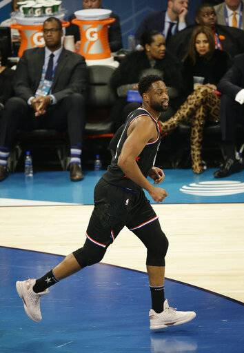 Team LeBron's Dwayne Wade, of the Miami Heat, works against Team Giannis during the second half of an NBA All-Star basketball game, Sunday, Feb. 17, 2019, in Charlotte, N.C.