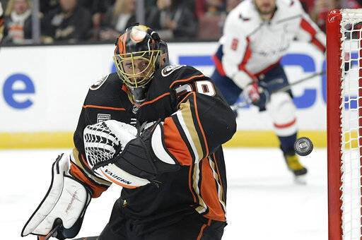 Anaheim Ducks goaltender Ryan Miller deflects a shot during the third period of an NHL hockey game against the Washington Capitals Sunday, Feb. 17, 2019, in Anaheim, Calif. The Ducks won 5-2. (AP Photo/Mark J. Terrill)