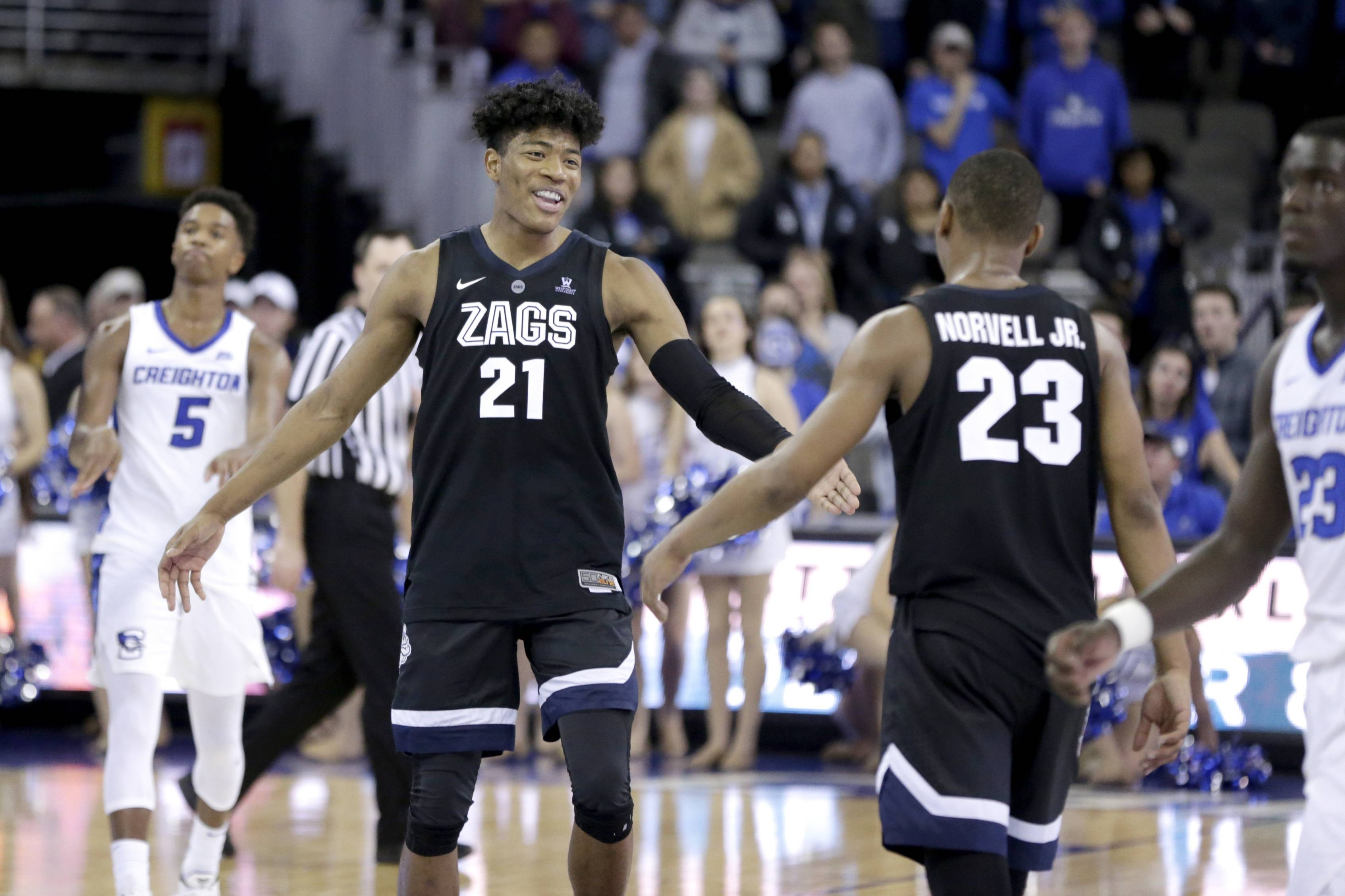 Creighton's Ty-Shon Alexander (5) walks on the court as Gonzaga's Rui Hachimura (21) celebrates with Zach Norvell Jr. (23) their 103-92 win over Creighton in December, Hachimura is expected to be the first Japan-born first-round pick. He has the size and shooting touch to fit into today's NBA as a small-ball four or five; averaging 20.3 points.