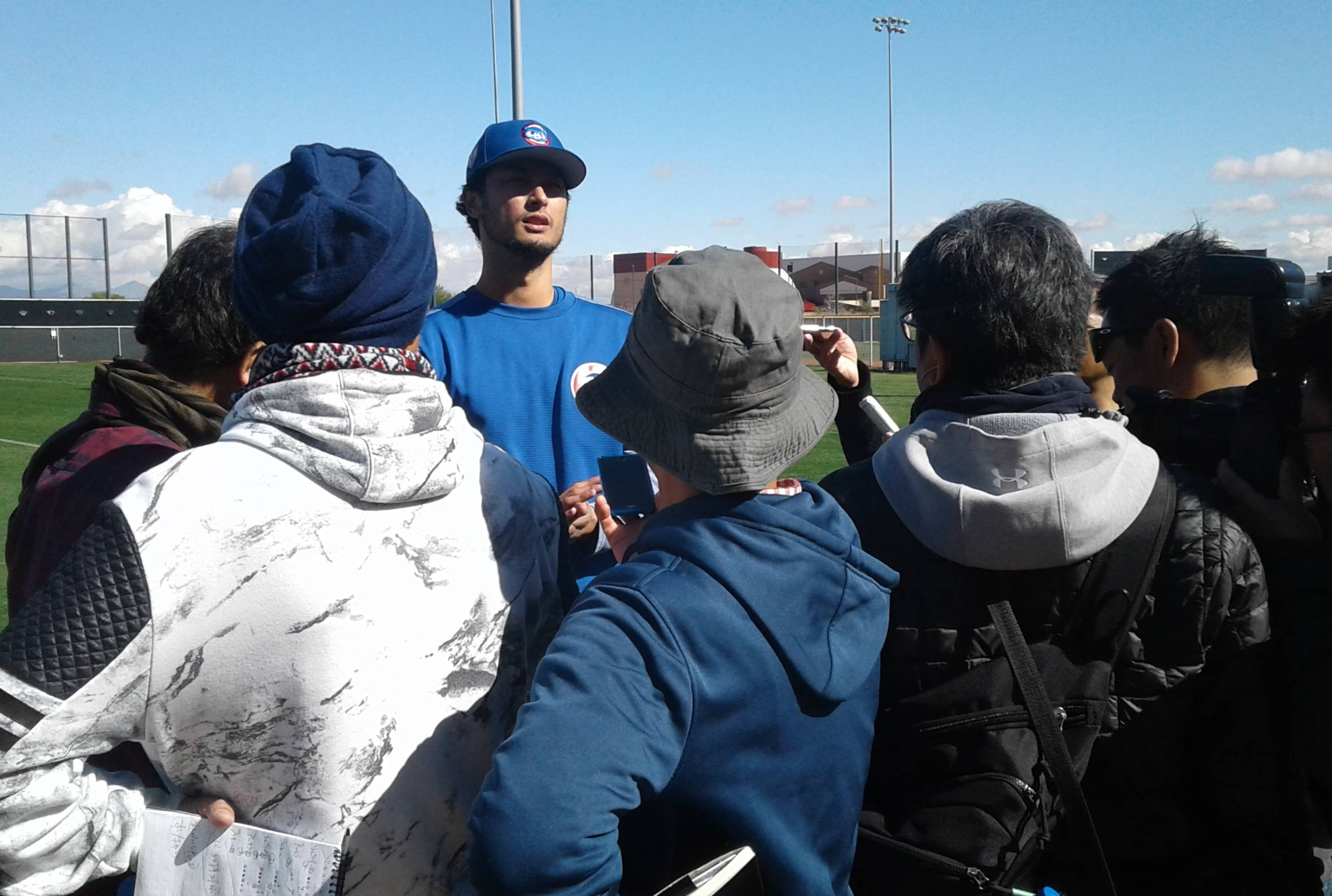 Cubs pitcher Yu Darvish addresses the Japanese media Tuesday at spring training camp.