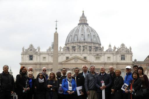 Members of the ECA (Ending of Clergy Abuse) organization and survivors of clergy sex abuse pose for photographers outside St. Peter's Square, at he Vatican, Monday, Feb. 18, 2019. Organizers of Pope Francis' summit on preventing clergy sex abuse will meet this week with a dozen survivor-activists who have come to Rome to protest the Catholic Church's response to date and demand an end to decades of cover-up by church leaders.