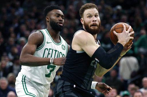 "File-This Feb. 13, 2019, file photo shows Boston Celtics' Jaylen Brown (7) defending against Detroit Pistons' Blake Griffin (23) during the second half of an NBA basketball game in Boston. A year after arriving in Detroit with his career at a crossroads, a more earthbound Griffin is doing all he can to shake the Pistons out of their decade-long malaise. ""He does a little bit of everything for us. Probably one of our better pick-and-roll players, passers, scorers, leader by example, just so many things,� Detroit coach Dwane Casey said. ""His basketball intellect, for me, is one that's been the most impressive of our players. I didn't know that about Blake, because when you think about him, you think about the high-flying dunker and the muscular guy in the post, but there's a lot more to that than just his dunking and athleticism.� (AP Photo/Michael Dwyer, File)"