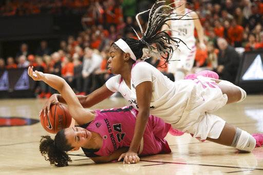 Oregon's Ruthy Hebard, right, and Oregon State's Destiny Slocum, left, scramble for a rebound during the first half of an NCAA college basketball game in Corvallis, Ore., Monday, Feb. 18, 2019.