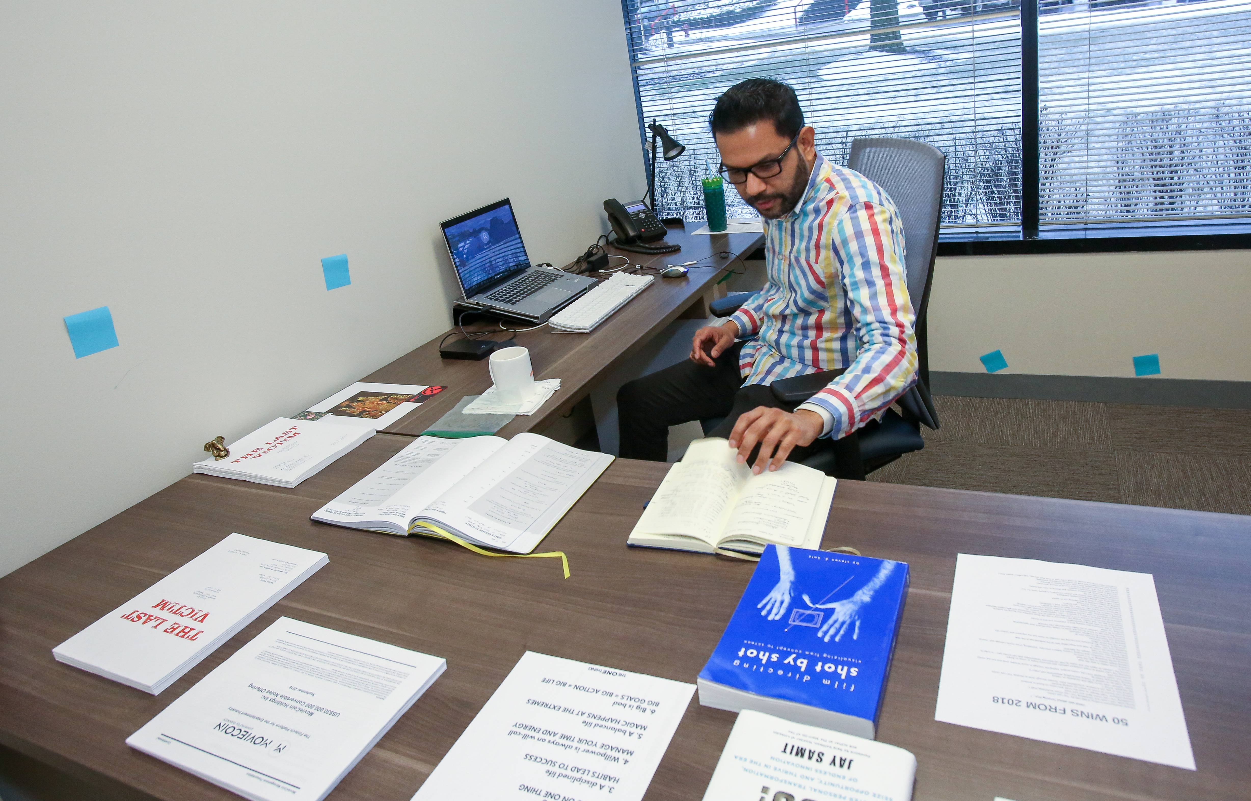 Naveen Chathappuram of Naperville uses his office at the Office Evolution coworking center in Lisle. Chathappuram, with Immortal Thoughts Film Production, said he uses the office as a convenient place to start work on his next film.