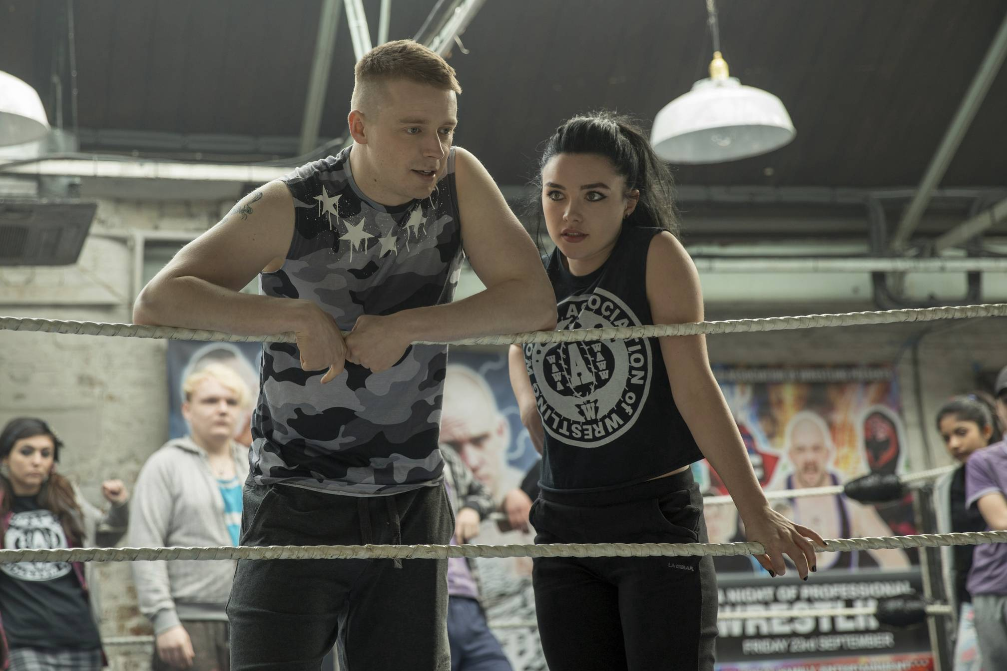 "Siblings Zak (Jack Lowden), left, and Saraya-Jade (Florence Pugh) work toward a shot at the WWE in ""Fighting With My Family."""