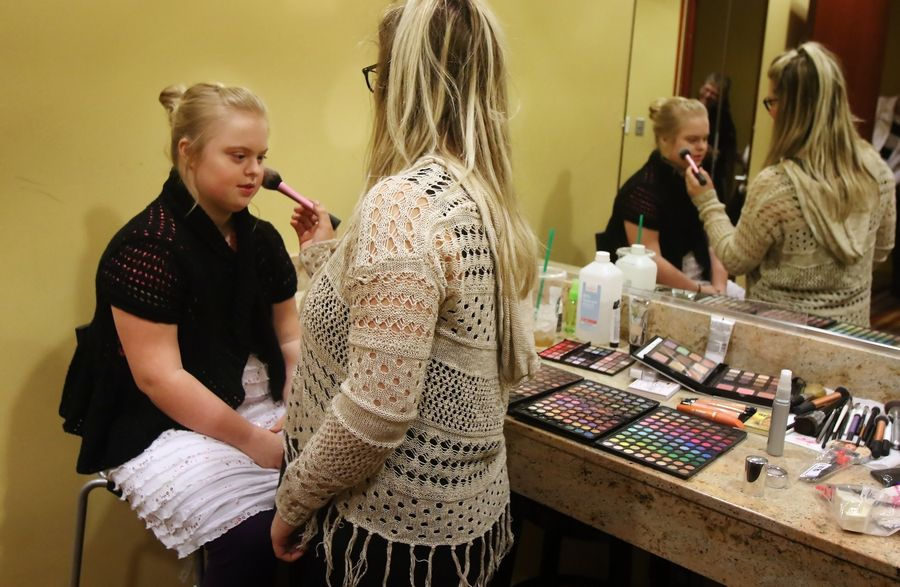 Rebecca Nalepa of Mount Prospect has makeup applied by stylist Kate Morgan of Forbici Salon and Spa before walking the runway during a Gold Medal Fashion Show at The Meadows Club in Rolling Meadows. This year's show takes place Sunday, Feb. 24.
