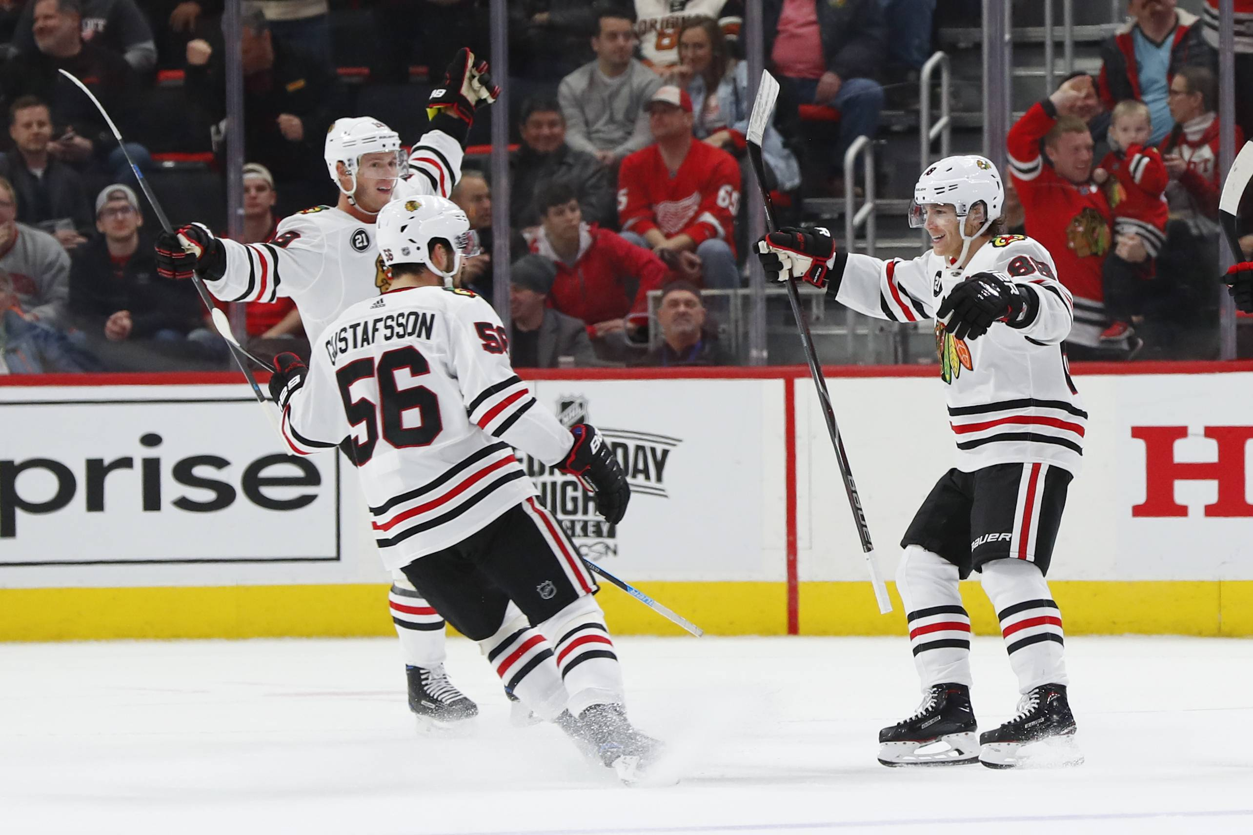 Blackhawks right wing Patrick Kane, right, celebrates his game-winning OT goal on Wednesday night in Detroit.