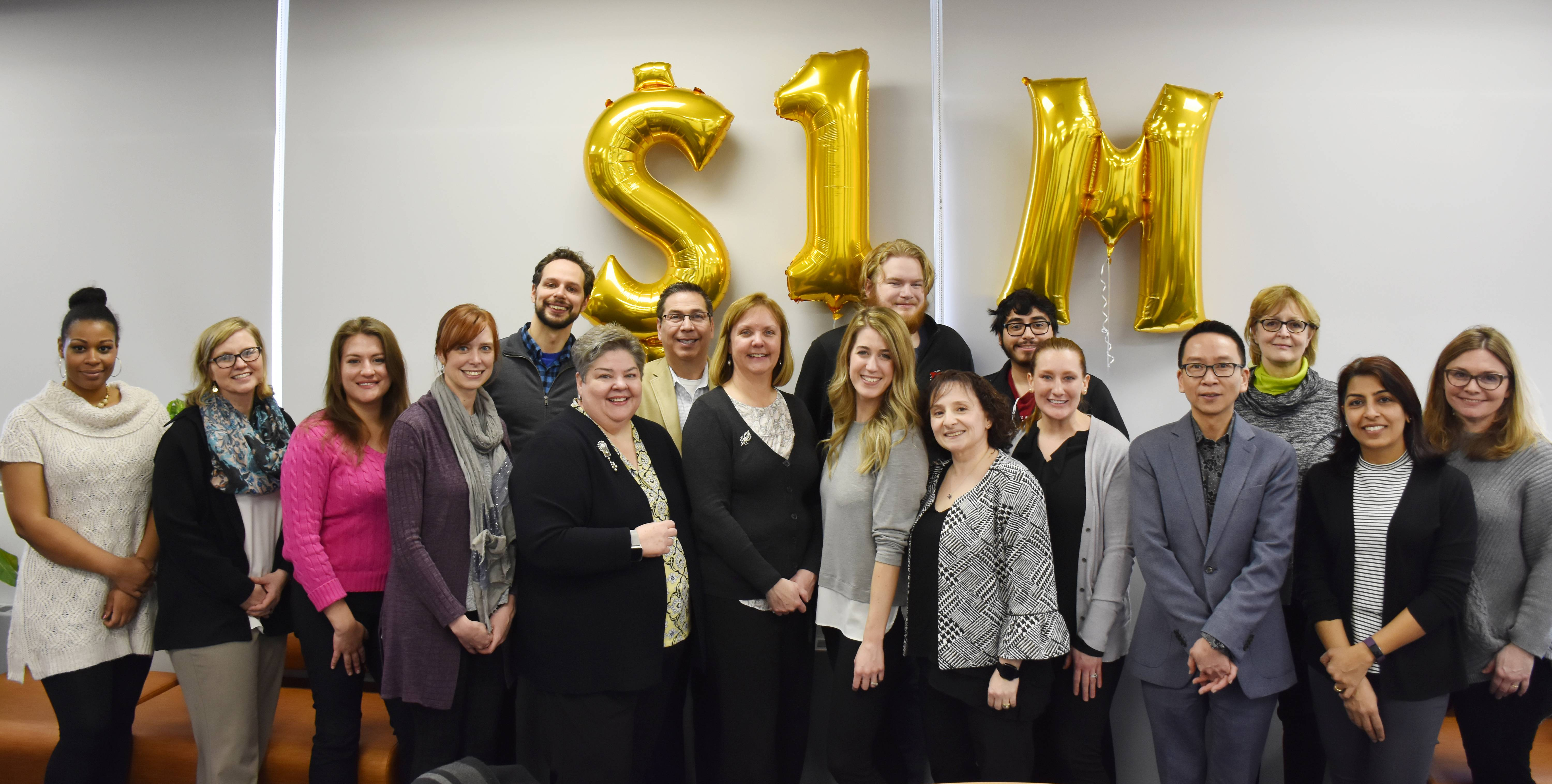 Photo: Triton College faculty, staff and students gathered on Feb. 13 to celebrate the milestone of saving students $1 million through the Low Cost/No Cost Textbook Alternatives initiativeSamantha Schmidt