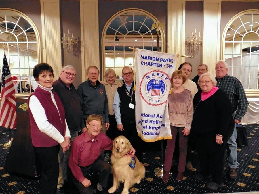 JoJo Comfort Dog visits with members of the National Active and Retired Federal Employees Chapter 1309. JoJo is part of the Lutheran Church Charities affiliated Comfort Dog Ministry at Living Christ Lutheran Church in Arlington Heights.