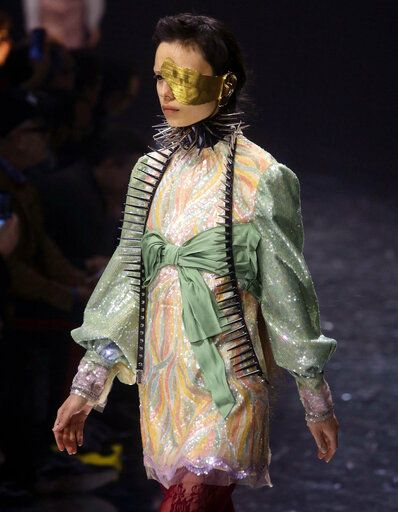 1e725db2ac8 A model presents a creation by Gucci women s fall-winter 2019-2020  collection