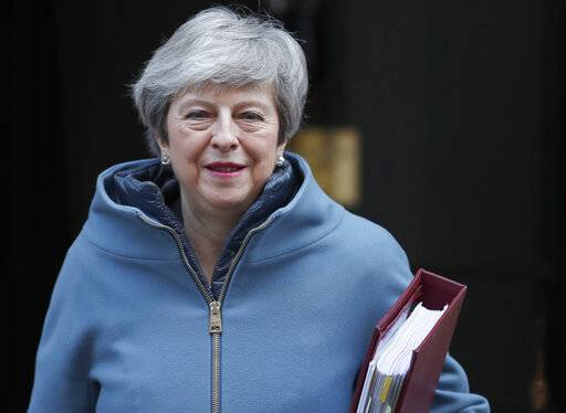 Britain's Prime Minister Theresa May leaves 10 Downing Street for the House of Commons for her weekly Prime Minister's Questions in London, Wednesday, Feb. 20, 2019. May is due to go the Brussels to meet EU leaders for further negotiation on Brexit. (AP Photo/Alastair Grant)
