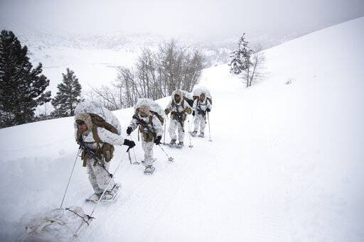 A group of U.S. Marines walk along a snow-covered trail during their advanced cold-weather training at the Marine Corps Mountain Warfare Training Center Sunday, Feb. 10, 2019, in Bridgeport, Calif. After 17 years of war against Taliban and al-Qaida-linked insurgents, the military is shifting its focus to better prepare for great-power competition with Russia and China, and against unpredictable foes such as North Korea and Iran. (AP Photo/Jae C. Hong)